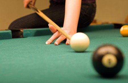 Billiard game (hand in focus) photo