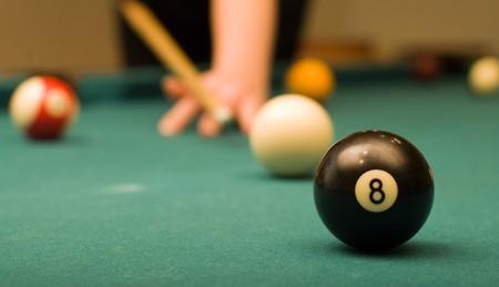 Billiard game (black ball in focus) photo