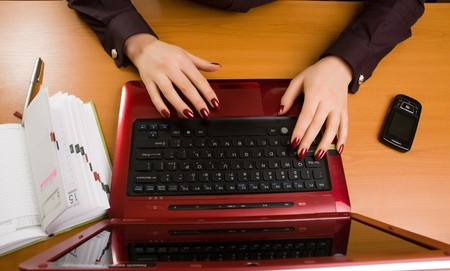 Business lady at desk writing. Stock Photo