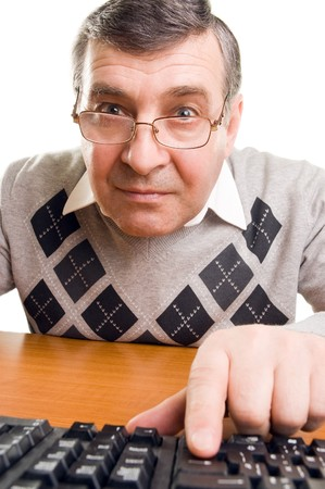 Senior man with computer (isolated on white) Stock Photo
