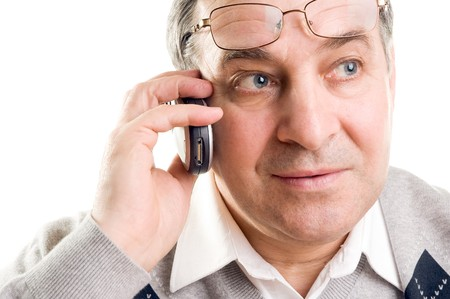 Senior man talking on mobile phone (isolated on white) photo
