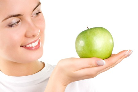 Beautiful young woman holding an apple Stock Photo - 4510654