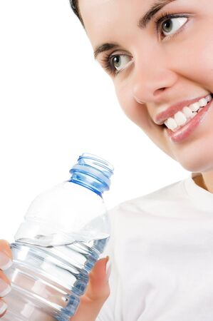Young beautiful girl with mineral water (isolated on white) photo