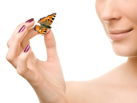Young beautiful woman holding a butterfly Stock Photo