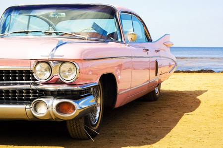 Classic pink car at beach Stock Photo - 4521426