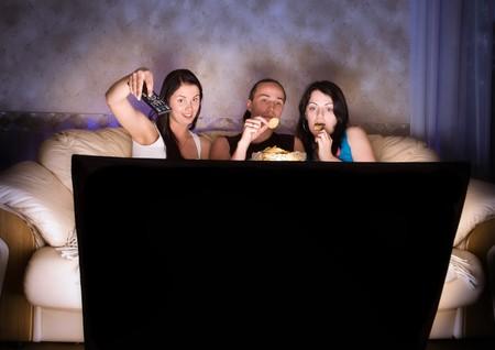 Three friends are watching TV Stock Photo - 4510652