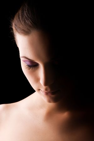 womans: Young beautiful womans dramatic light portrait Stock Photo