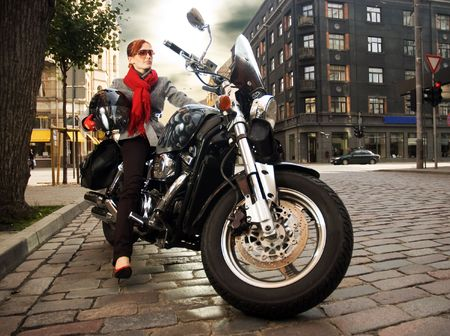 Beautiful woman on the motorcycle photo
