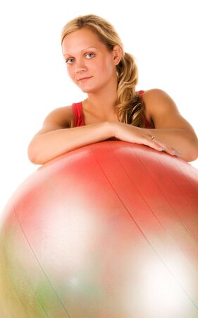 Blond woman exercising with a pilates ball  photo