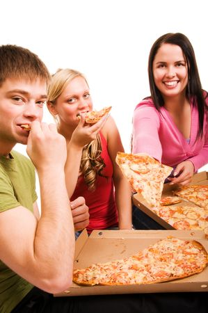 Friends having fun and eating pizza photo