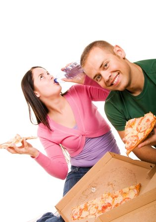 Young man and young woman eating pizza photo