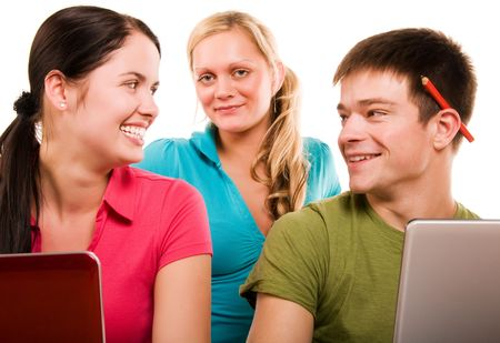 Group of students having fun, doing home work (isolated on white) Stock Photo - 5319855