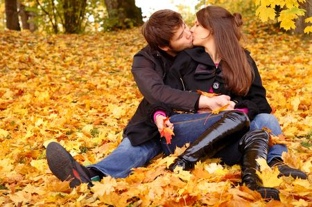 autumn leafs: Happy couple outdoors
