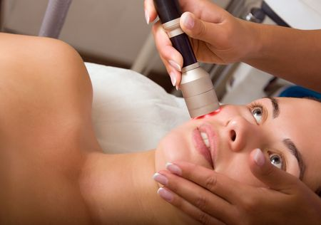 Young woman getting skin cleaning at beauty salon (shallow dof) Stock Photo - 5406008