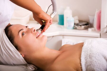 Young woman getting skin cleaning at beauty salon (shallow dof) Stock Photo - 5406014