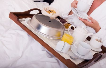 Woman with breakfast in bed photo