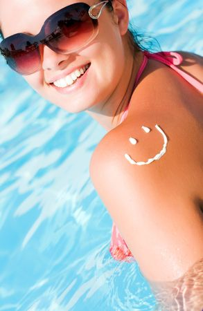 A smile made with suncream at the shoulder