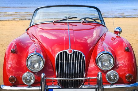 custom car: Old classic red car at the beach