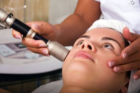 Young woman getting skin cleaning at beauty salon (shallow dof) Stock Photo - 5612765