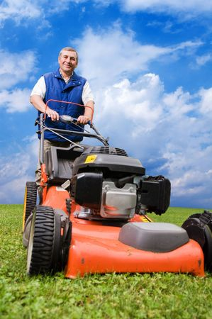 Senior man mowing the lawn. Stock Photo - 5612766