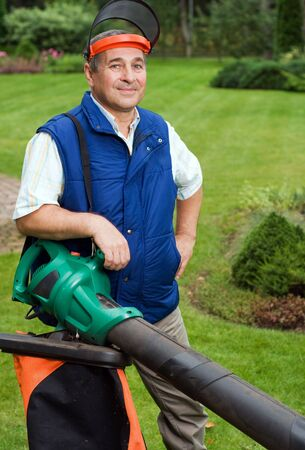 Man with leaf blower  photo