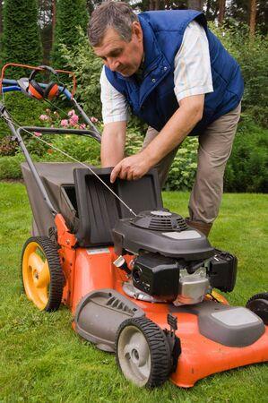 Senior man mowing the lawn Stock Photo - 6807296