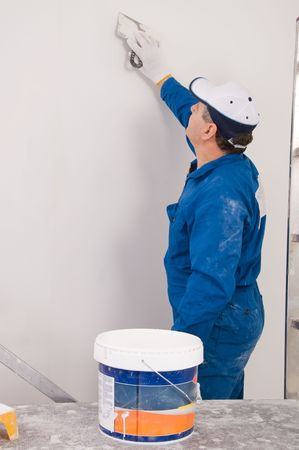man painting: Man painting the wall  Stock Photo