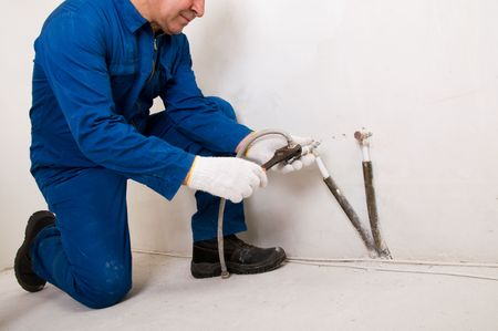 Plumber fixing water pipe Stock Photo - 6807154