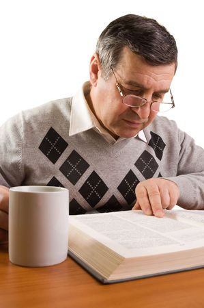 research study: Senior man reading a book Stock Photo