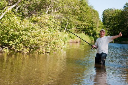 A fisherman fishing on a river Stock Photo - 7445820
