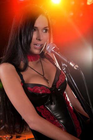 Glamorous girl  singing on the stage Stock Photo - 8341338