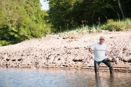 A fisherman fishing on a river Stock Photo - 8786276