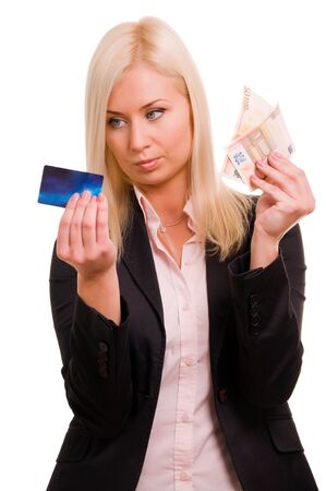 Business woman with a credit card and cash in her hand Stock Photo - 8786117