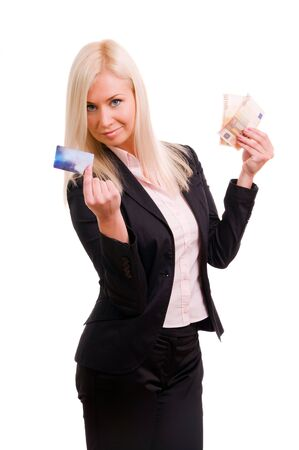 Business woman with a credit card and cash in her hand photo