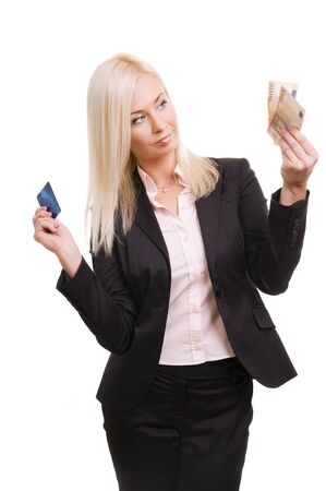 Business woman with a credit card and cash in her hand  Stock Photo - 8786089