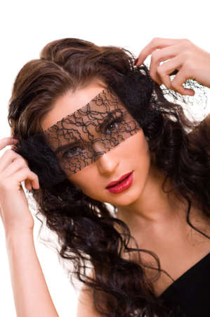 Portrait of young beautiful brunette woman with lace on her eyes photo