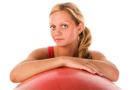 Blond girl exercising with a pilates ball  photo