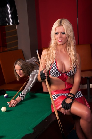 billiards tables: Happy girls playing in billiard