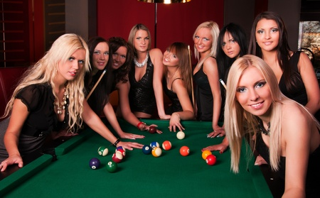 parting:  Group of happy girls playing in billiard Stock Photo