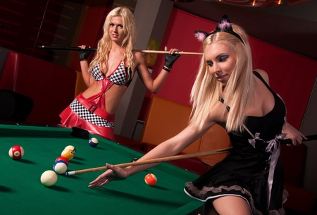 Happy girls playing in billiard