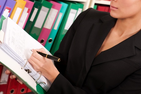 Business woman filling files in the  folders  photo