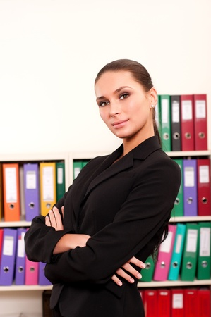 Business woman in front of shelves with folders Stock Photo - 11854187