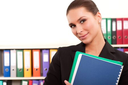 Business woman in front of shelves with folders Stock Photo - 11854126