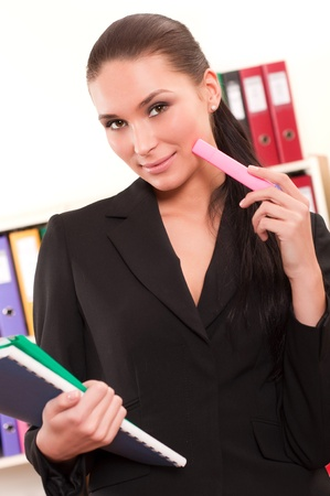 Business woman in front of shelves with folders Stock Photo - 11854276