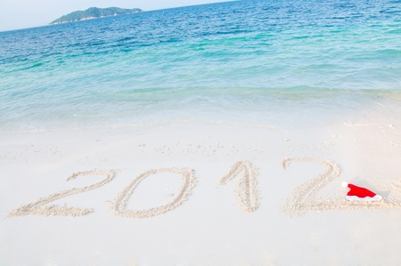 Numbers 2012 on tropical beach sand  photo