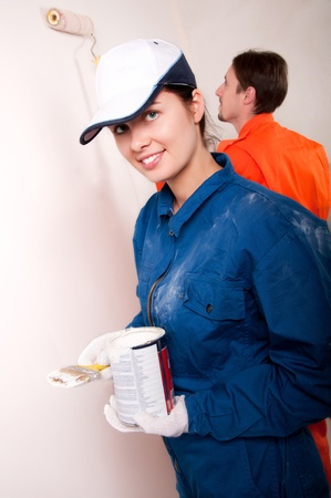 Construction workers at work, preparing to paint  Stock Photo - 12461671