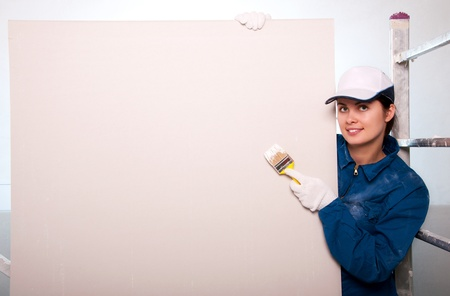gypsum: Woman painting the wall  Stock Photo