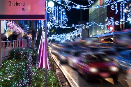urban road: Orchard Road, Singapore. The street and buildings with lights and decorative items in preparation for Christmas. motion blurred Stock Photo