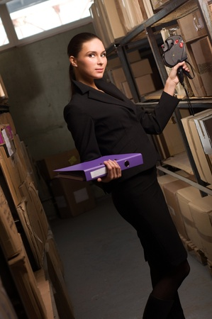 data distribution: Business woman stock counting in warehouse