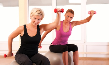 dumbells: Group of people doing fitness exercise Stock Photo